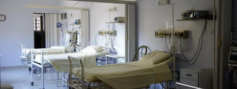 empty hospital beds on a ward
