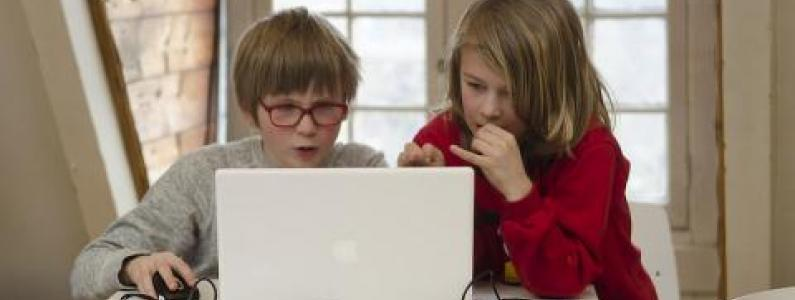 two children at a laptop