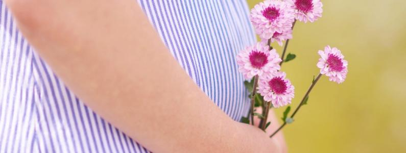 Pregnant Woman holding flowers