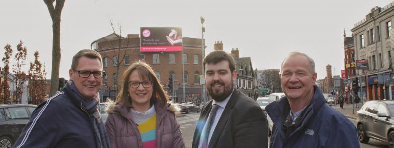 Care in Northern Ireland team with a billboard