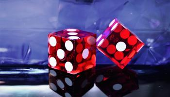 2 dice on a blue background