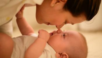 mother and baby rubbing noses