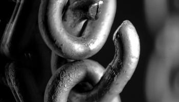 A black and white image of chains