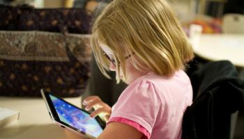young child with a tablet