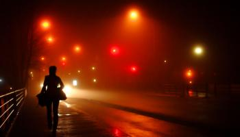red lights and woman walking alone