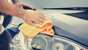 hand washing a car at a car wash