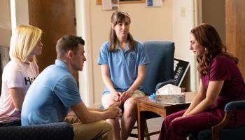 Movie still from Unplanned movie, shows Abby Johnson meeting pro-life advocates