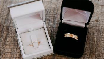 white and black wedding ring and boxes