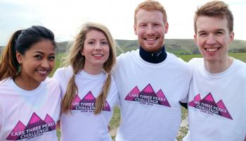 CARE team members in Three Peaks Challenge t-shirts smiling in the countryside