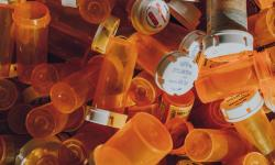 pile of plastic orange medicine bottles